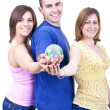 Three students holding globe — Stock Photo