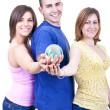 Three students holding globe — Stock Photo