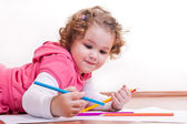 Adorable girl is drawing — Stock Photo