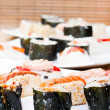 Plates with sushi rolls — Stock Photo