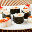 Plate with delicious sushi rolls — Stock Photo