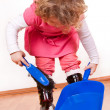 Little girl helping - Stock Photo