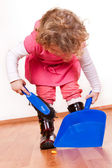 Little girl helping — Stock Photo