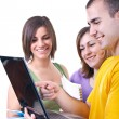 Students and laptop — Stock Photo #3299350
