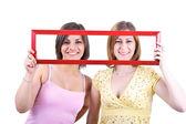 Girls holding frame — Стоковое фото