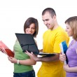 Smiling students with laptop — Stock Photo #3339344