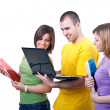 Smiling students with laptop — Stock Photo