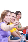 Students holding thumbs up — Stock Photo