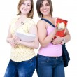 Female students with books and apple — Stock Photo