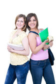Two students with books and apple — Stock Photo