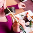 Close up of woman eating sushi — Stock Photo