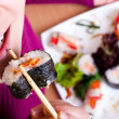 Stock Photo: Eating sushi