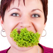 Funny eating salad — Stock Photo