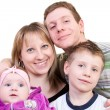 Smiling happy family - Stock Photo