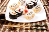 Different kind of sushi on plate — Stock Photo