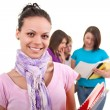 Female student and friends in back — Stock Photo