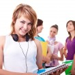 Student with books and earphones — Stock Photo #3646324