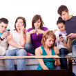 图库照片: Teenagers - mobile mania