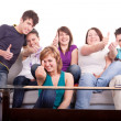 Group of teenagers holding thumbs up — Stock Photo