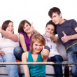 Teenagers holding thumbs up — Stock Photo