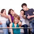 Stock Photo: Teenagers holding thumbs up