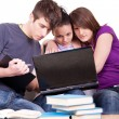 Three student studying on laptops — Stock Photo