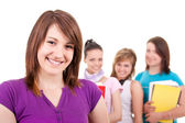 Smiling student and her friends — Stock Photo