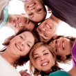 Smiling teenagers in circle - Stock Photo