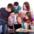 Students looking at  book — Stock Photo