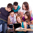 Royalty-Free Stock Photo: Students looking at  book