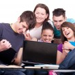 Group of teenagers with laptop — Stock Photo