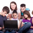 Teenagers looking at laptop — Stock Photo #3691420
