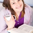 Girl with book anf coffee — Stock Photo #3691706