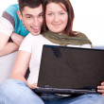 Happy couple with laptop — Stock Photo #3691882