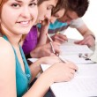 Student studying with her friends - Stock Photo