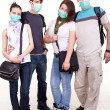 Teenagers with protection masks - Stock Photo