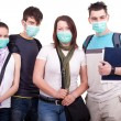 Teenagers with masks for protection - Stock Photo