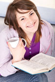 Girl with book anf coffee — Stock Photo