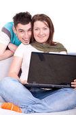 Happy couple with laptop — Стоковое фото
