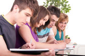 Student studying with her friends — Stock Photo