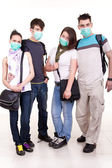 Teenagers with protection masks — Stock Photo