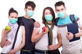 Groep van jonge met masker — Stockfoto