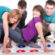 Stock Photo: Teenagers playing twister