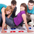 Teenagers playing twister — Stock Photo