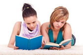 Two young girls reading books — Стоковое фото