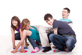 Young teenagers playing twister — Stock Photo