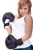 Woman with boxing gloves threatening — Stock Photo
