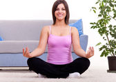 Woman meditating in her apartment — Stock Photo