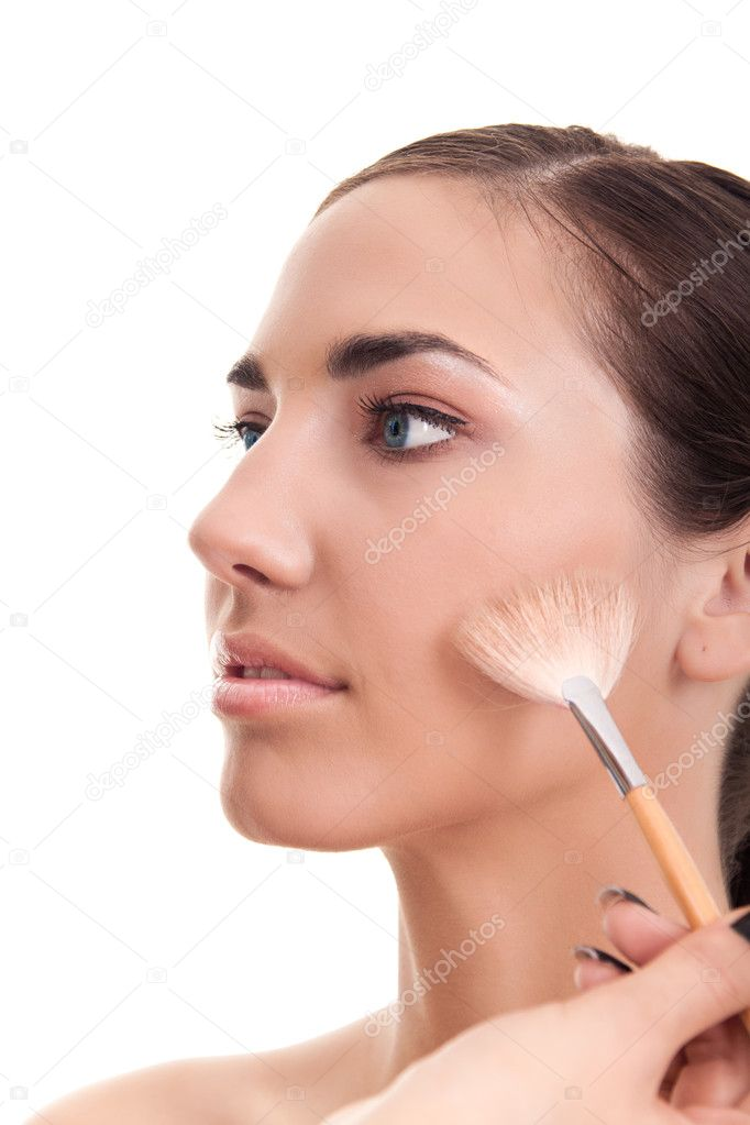 Close-up of a woman applying make-up isolated on white  Stock Photo #3797603