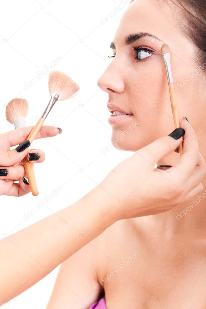 Close-up of a woman applying make-up isolated on white — Stock Photo #3797617